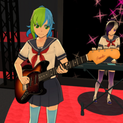 Beshi playing the bass in the Light Music Club.