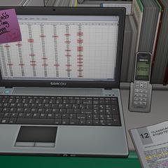 Computadora portátil y teléfono Saikou.