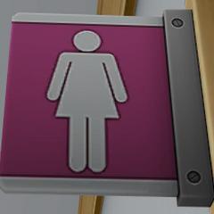 Señal en los baños de mujeres.