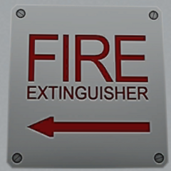 Sign indicating a fire extinguisher's location. July 12th, 2016.