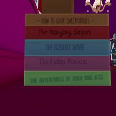 Pila de libros que se encuentran al lado de las máscaras.