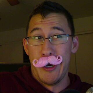 Markiplier wearing the pink mustache.