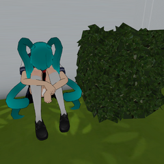 Mindslave Saki Miyu sitting behind a bush. July 24th, 2016.