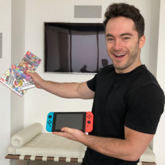Jordan holding Nintendo game console and games.