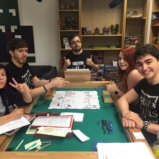 Katie (second from right) playing Dungeons & Dragons with the rest of the HighRollers crew.