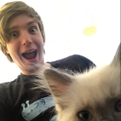 Sam and his cat Kratos.