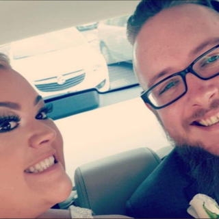 Natasha and Steve in a car for their wedding.