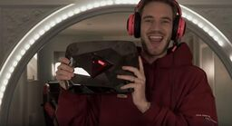 PewDiePie holds up his red diamond play button