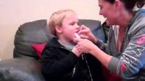 Pulling First Loose Tooth December 2011