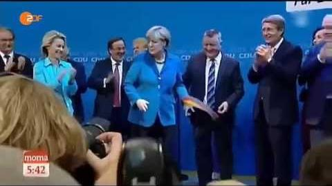 Angela Merkel visibly disgusted by German flag - Throws it away during celebration