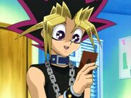 148 yugi holding card smile