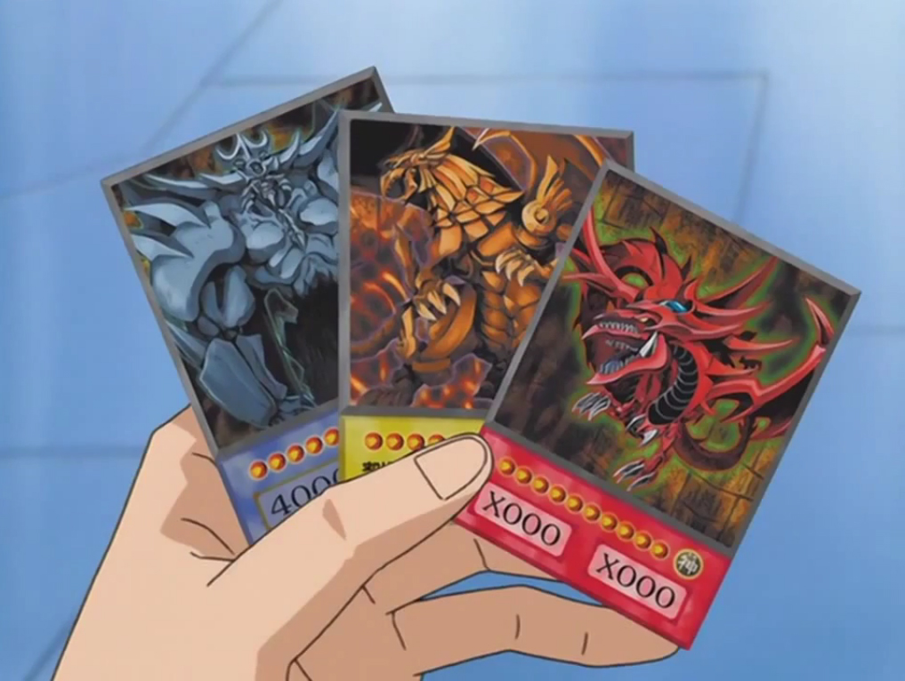 Yugi Holding The 3 Egyptian God Cards At End Of Battle City Tournament