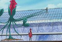 Yusei suspended by Aki's vines