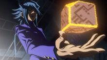 Aigami con un objeto desconocido