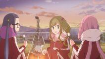 Trio by school campfire