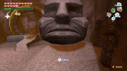 Link levantando una Cabeza de Piedra en la Isla del Volcán en TWW HD