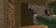 Skyward Sword - Link colocando la litografía del orbe rojo en el efigie