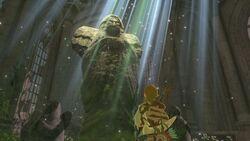 Link frente a una estatua de la diosa BotW