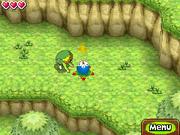 Link cogiendo una bomba