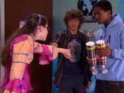 Logan runs his fingers along Quinn's forearm