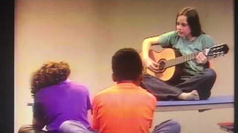 Zoom Pilot Episode Nina playing her guitar.