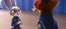 Judy presenting Nick with badge