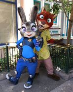 Judy pose with Nick's tie